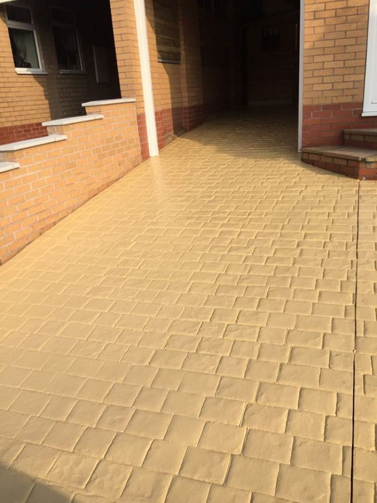 yellow / beige floor small block paving squares - after clean and seal