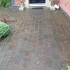 before work carried out , block paving with weeds growing through